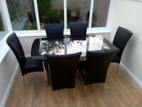 Glass dining table & six chairs