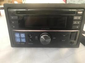 Alpine CDE-W233R Double DIN iPod direct stereo system.