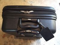 Black, hard sided wheeled Chubb suitcase for sale.