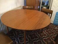 Round table with four chairs , good clean condition