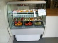 Serve over display fridge,, with fridge compartment underneath,,