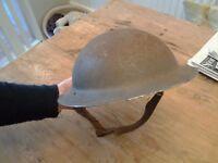 Genuine British WW2 helmet with chin strap.