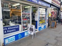 phone shop -section - in dryclean shop - business running now