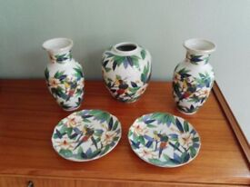 A matching set of beautifully painted small vases and decorative plates