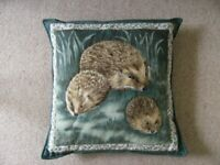 Scatter cushion hedgehog print with embossed animals, adult and two hoglets