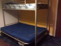 Bunk bed, single on top of either sofa or double bed, rarely used, very clean condition
