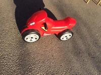 Red, plastic ride-on motorbike.