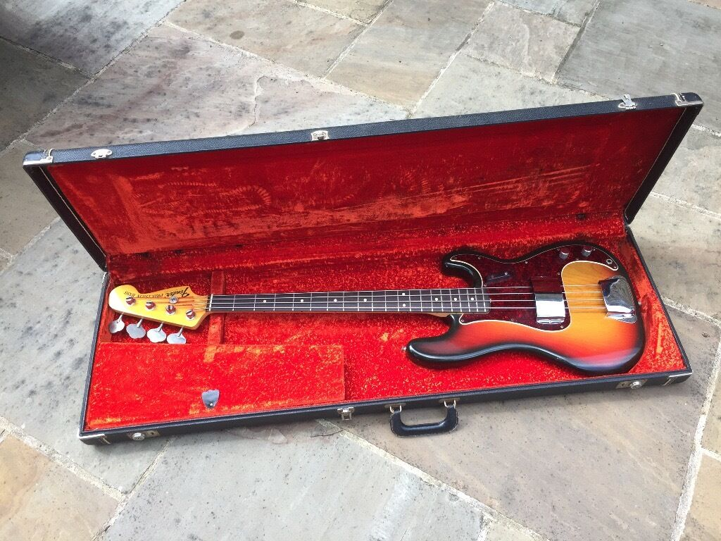 """1973 Fender Precision Bassin Woking, SurreyGumtree - Great condition all original sunburst 1973 Fender Precision Bass with original case (missing one latch drop). Lightweight and terrific player has some """"bubbling"""" to the finish on the body rear no doubt caused by years of lying in its case atop a..."""