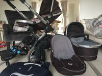 Icandy travel system with removable buggy board and a baby carrier