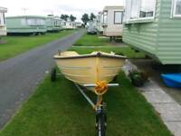 A bonowitco 200 on lunching trailer great wee boat for a tender or fishing.