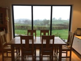 solid oak dinning table and solid oak chairs