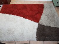 2 x Very contemporary shaggy pile rugs.