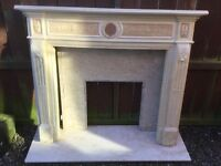 Composite marble hearth, inset and fire surround.