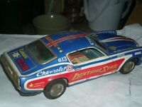 TWO JAPANESE TIN PLATE CARS FOR SALE