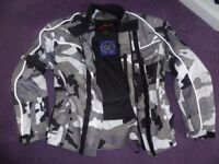 Two piece XS ladies/teens motorcycle jacket and trousers
