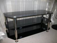 Television Stand in dark glass and chrome legs