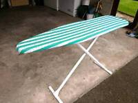 Ironing board with iron.