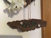 Handmade driftwood love sign