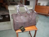Beautiful brand new holdall with tags.