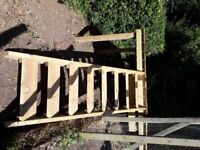 Raised wooden decking platform with steps