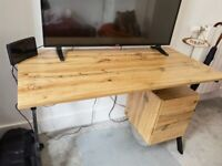 Selling brown and black desk, it has a drawer and a little cupboard