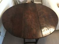 Antique round drop side leaf dining table and six chairs
