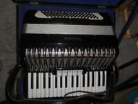 Piano Accordian in case with tutorial books