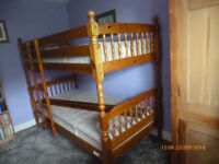 Bunk beds c/w mattresses in solid pine. Bolted joints for easy dismantling and transport.