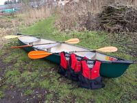 Excellent condition 3 man Explorer canoe with paddles and Life jackets - Ready for the river.