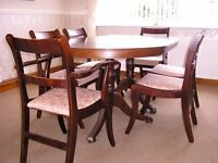 Mahogany extending Dining Table and 6 chairs including 2 carvers and protective cover.