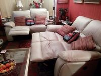 Two leather reclining two-seater sofas in very good condition.