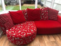 Red patterned corner sofa with matching rotating armchair, used but in brilliant condition.