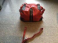 BRAND NEW blood red and black bag. 2 zip pockets outside & 2 larger zip pockets inside