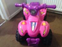 Girls pink quad bike