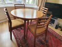 Teak Round Extending dining table with 4 upholstered dining chairs