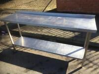 Stainless steel catering table on wheels