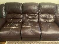 Recliner leather sofa . Free to a good home .