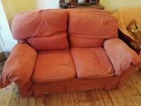 Two seater orange fabric sofa