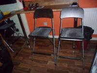 Silver and black folding bar chairs with seat pads
