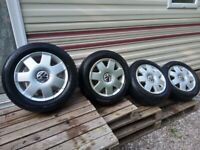 """VW 14"""" 5X100 Set Of Alloy Wheels Wrapped in 185 60 R14 Tyres With Centre Caps"""