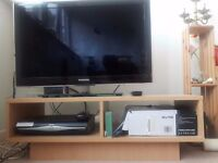 32 inch SAMSUNG LED TV with two pin plug and a free TV table