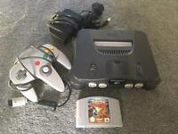 Nintendo 64 console with official n64 controller and Pokemon stadium game