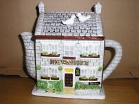 A small collectable teapot called: Emmerdale the Woolpack, by Annie Rowe.