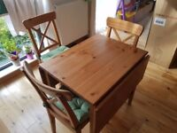 IKEA solid wood dining table + 4 chairs