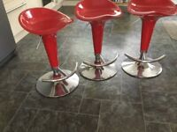 Red adjustable height shaped bar stools with footrest