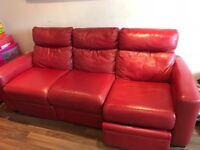 Red leather sofa with electric recliner(not working)