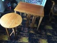 nest of tables three round ones under one oblong table , four tables in all