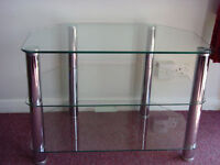 tv table ,clear glass, three shelf, good condition.