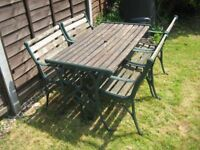Quality Heavy And Durable Cast Iron And Oak Garden Table And Four Chairs.