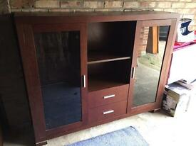 Solid dark brown cabinet with lights